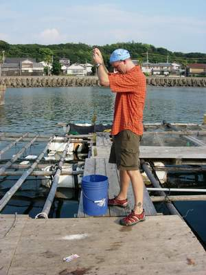 Allen collecting traps from the floating docks